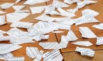 Scraps of papers on tiled floor