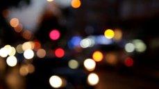 stock-footage-defocused-car-lights-at-night