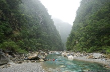 River tracers fording a river valley near Taroko Gorge.